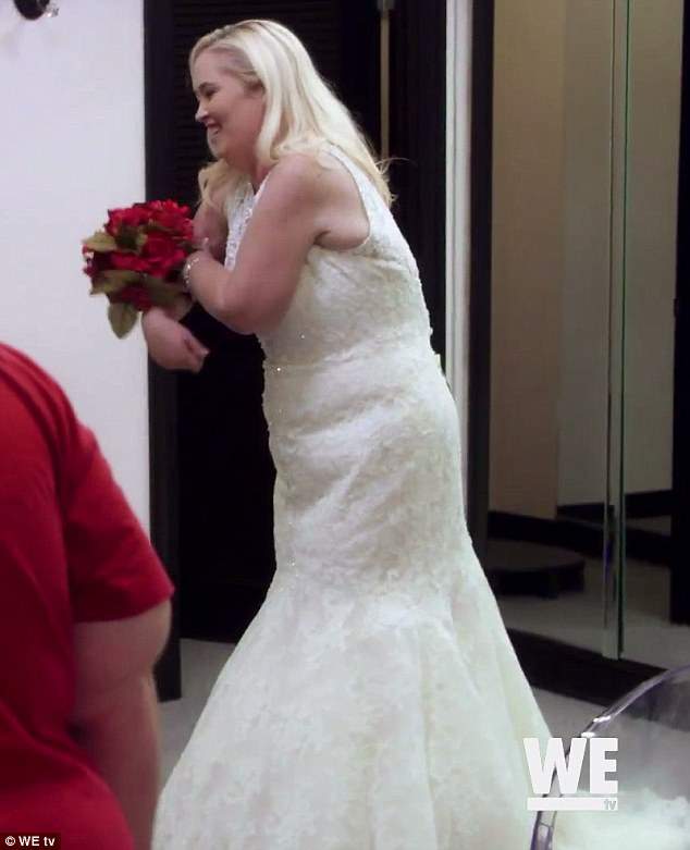 Shedding for her ex's wedding: Mama June was shopping for flower girl dresses for her daughter when she agreed to try on a gown herself