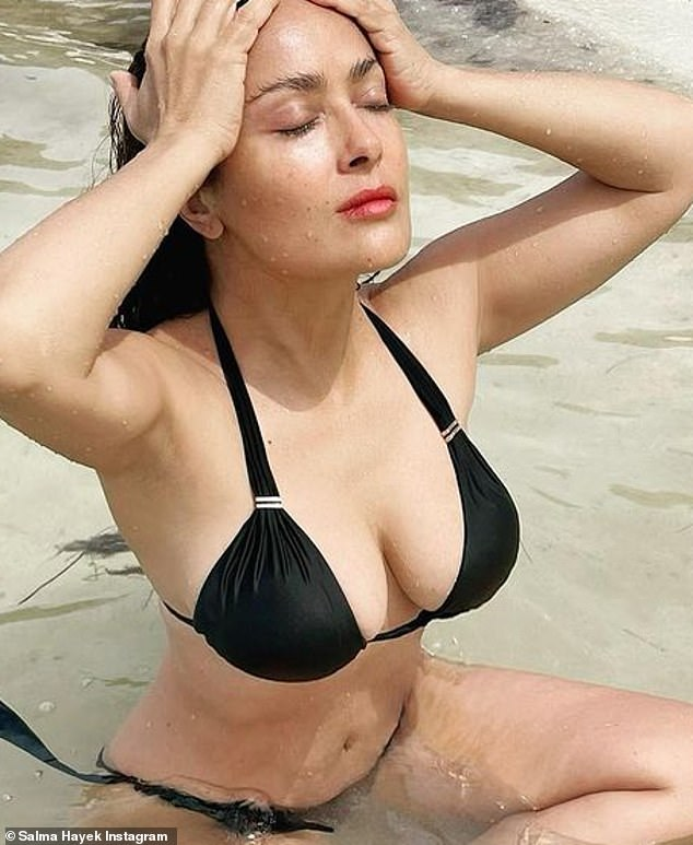 Flawless:The beauty looked half her age as she had slender arms, a very small waistline and sculpted arms that made her look great in the bikini. Her long black hair was wet and slicked back as she wore minimal makeup for the pinup shoot