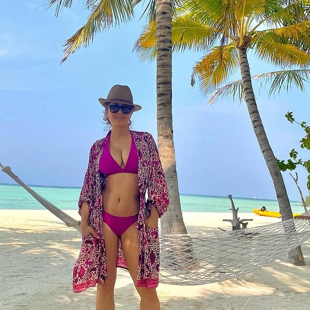 Life's a beach for Hayek: The Fools Rush In star has been in the tropics with her family