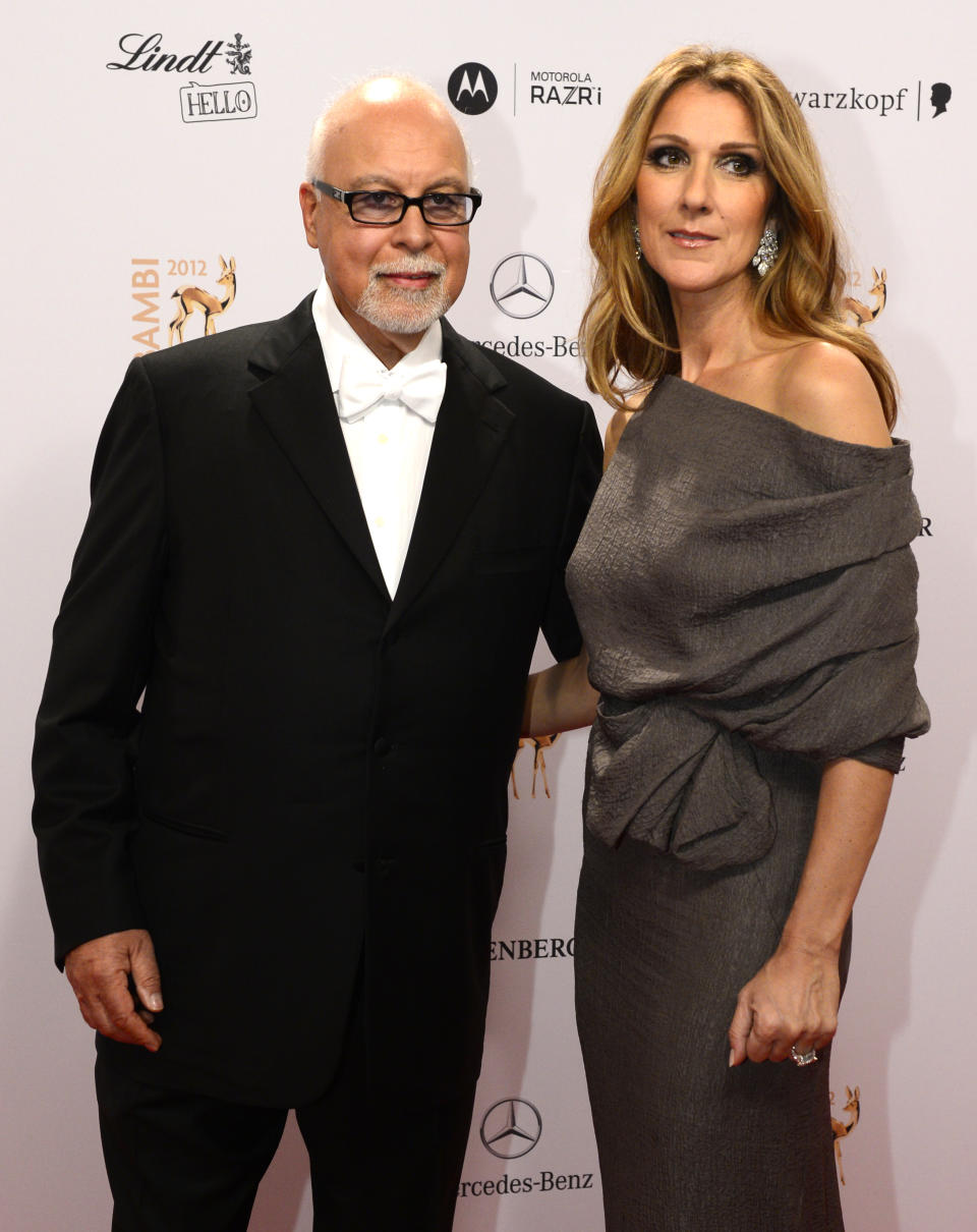 Canadian singer Celine Dion (R) and her husband Rene Angelil pose for photographers as they arrive on the red carpet for the Bambi awards in Duesseldorf, western Germany, on November 22, 2012. The Bambis are the main German media awards. AFP PHOTO / JOHN MACDOUGALL        (Photo credit should read JOHN MACDOUGALL/AFP via Getty Images)