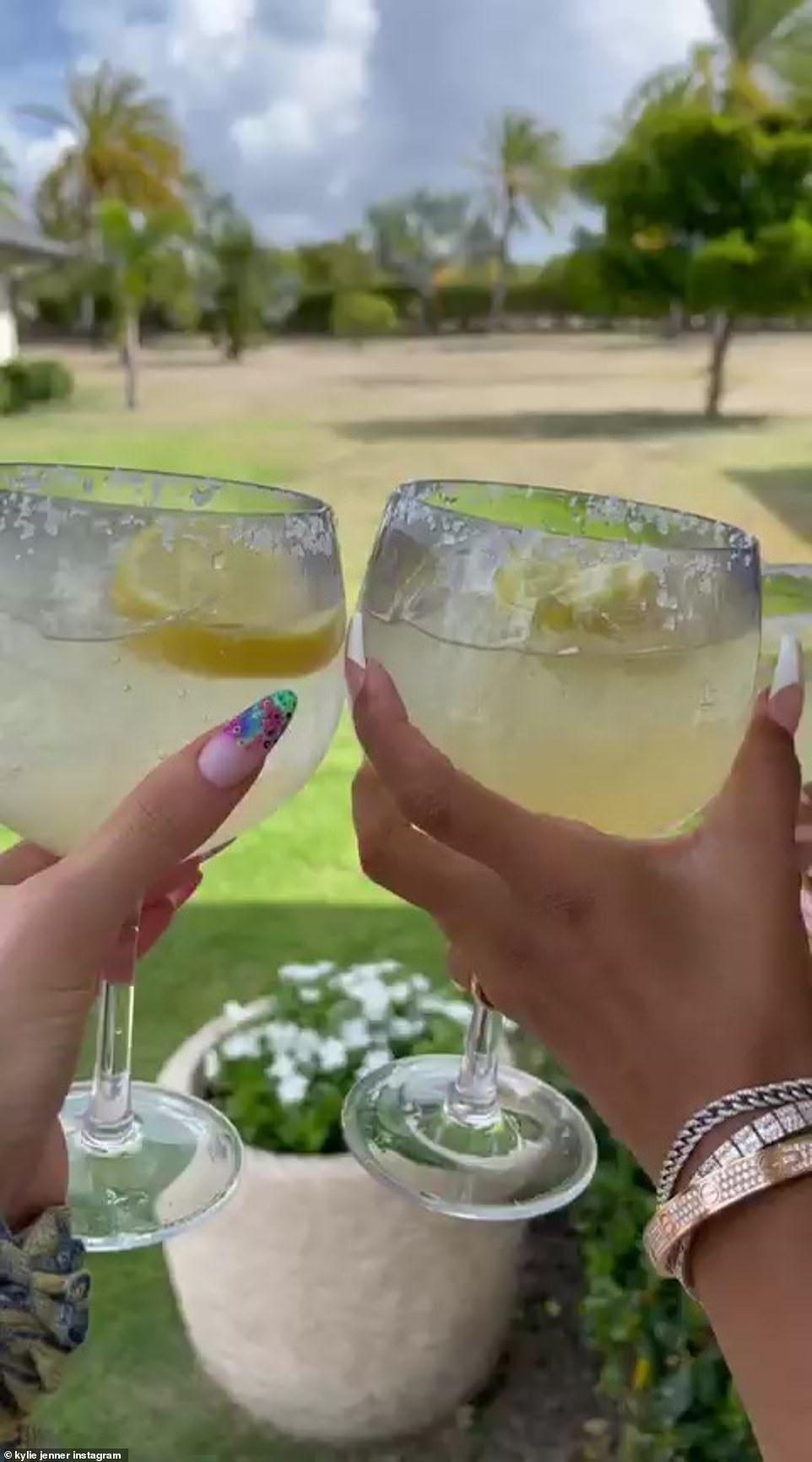 Cheers to us: The star, who is showing off her Cartier bracelets, cheered her tequila drink with her pretty pal