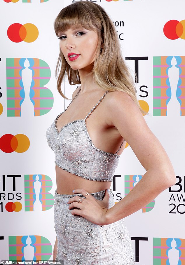 Superstar:Meanwhile Scooter has lately been locked in a notorious feud with Taylor Swift who is pictured at the Brit Awards in London this May