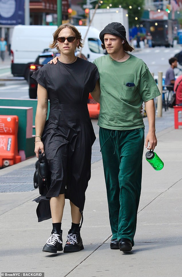 Changing style: Tommy sparked speculation from fans about her gender identity this past year after changing her appearance (Pictured with actor Lucas Hedges last month in NYC)
