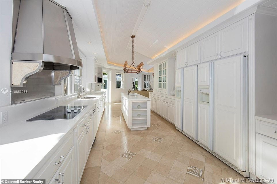 Kitchen goals:The kitchen features white cabinetry, with matching countertops; the large room, which had plenty of natural light, had a long island in the center for more space for cooking and baking
