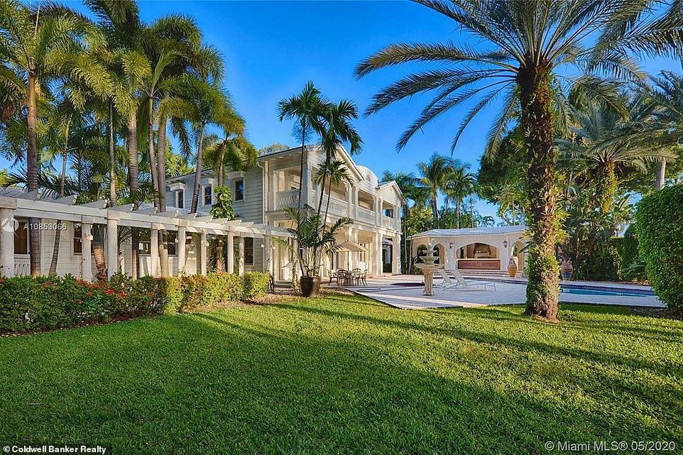 Views on views:The Floridian-style villa also has a private guest house with three-bedrooms, two full baths with a 1.5 bath; the guest house is located separate and in the front of the property