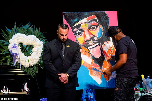 An artist painted a painting of Markie at a memorial service held Monday at New York's Patchogue Theater for the Performing Arts