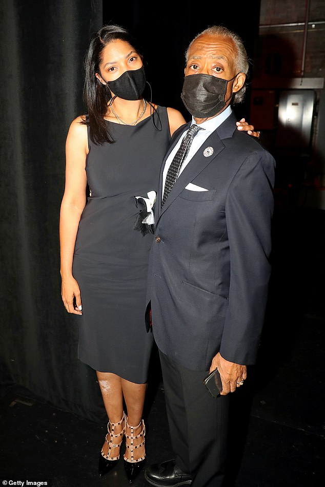 Rev. Sharpton posed with the musical artist's widow Tara Hall at the service