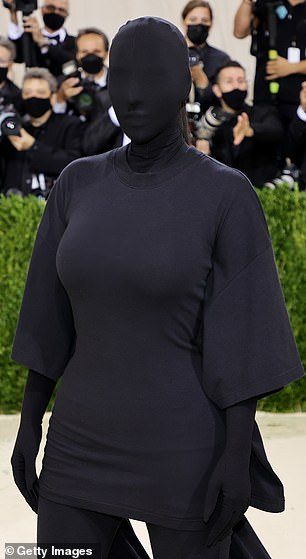 Avant garde: Kim's look managed to show off her curves despite it being completely black