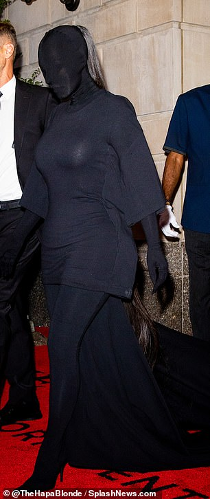 Heading out: Earlier in the evening Kim was seen leaving the Ritz-Carlton Hotel