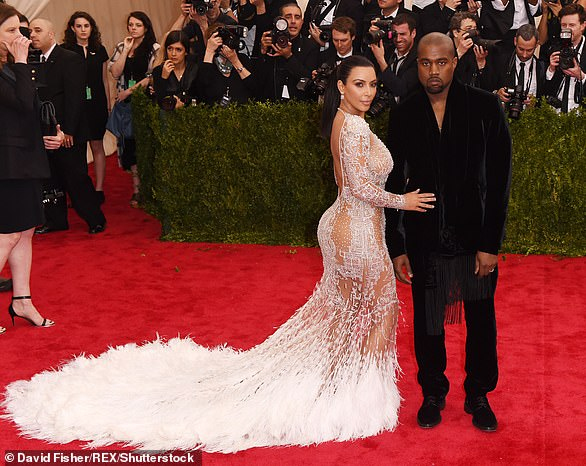 Sex appeal:She wore Roberto Cavalli for the May 2015 event. And the star posed with husband Kanye West who went with a black suit. The theme was celebrating China: Through the Looking Glass