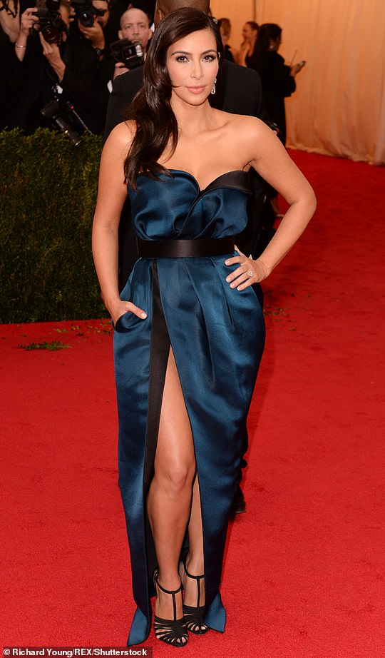In 2014, Kim had on a blue strapless Lanvin outfit as Kanye had on black. The theme was Charles James: Beyond Fashion