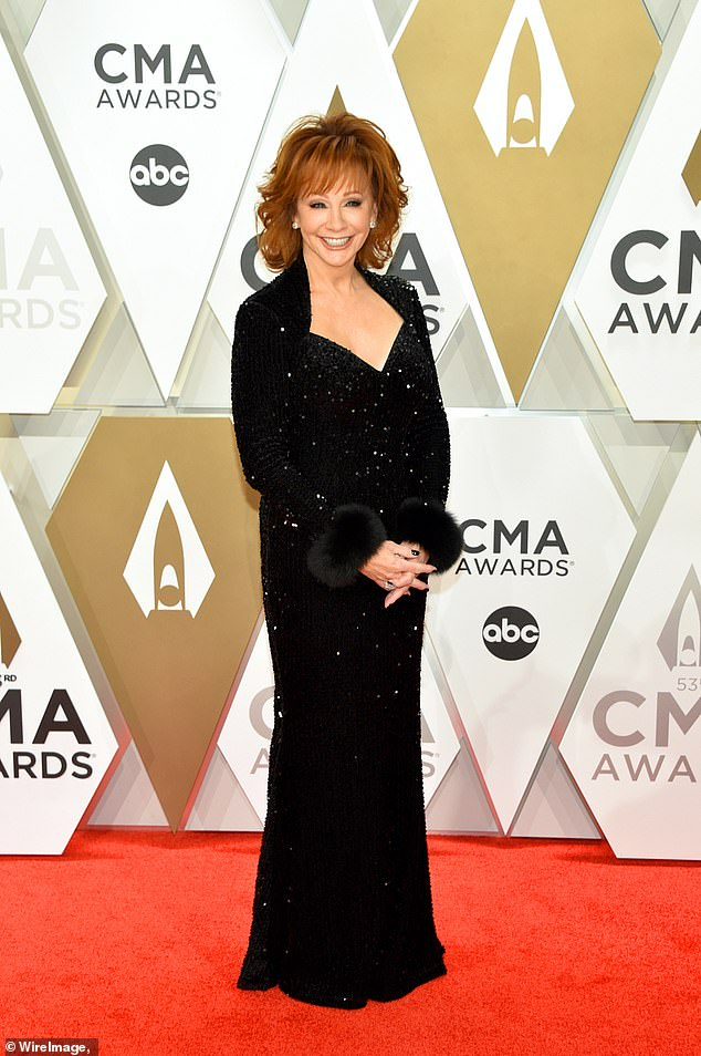Scary situation:Reba McEntire was rescued from a historic building in Oklahoma after a staircase collapsed while she was touring the 100-year-old structure; seen in 2019
