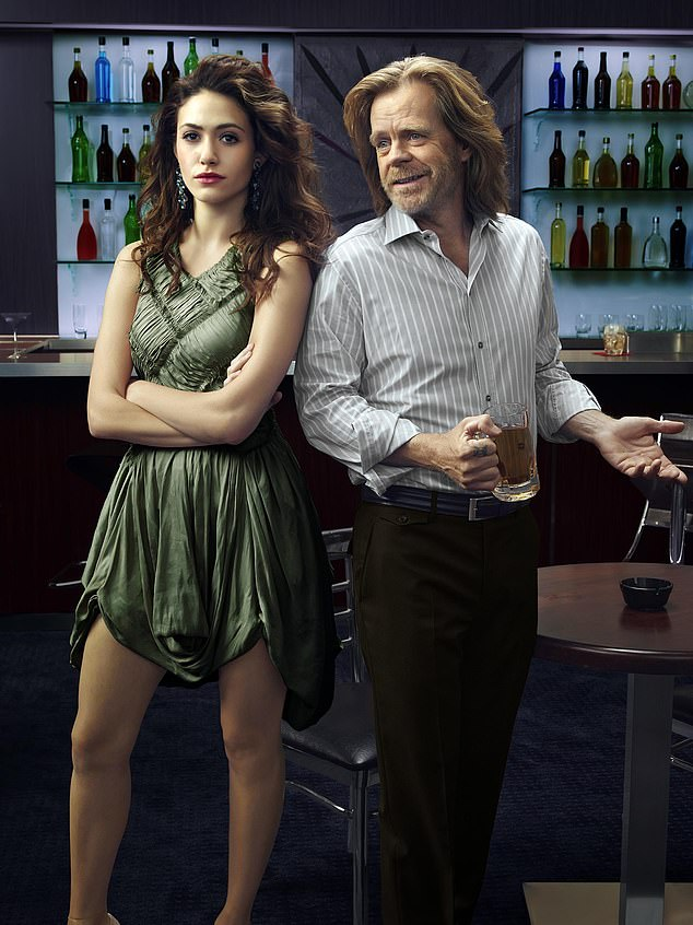 On-set drama: Kenney said the set became more 'positive' after Rossum left in 2019; Rossum seen with William H. Macy in a publicity still for Shameless