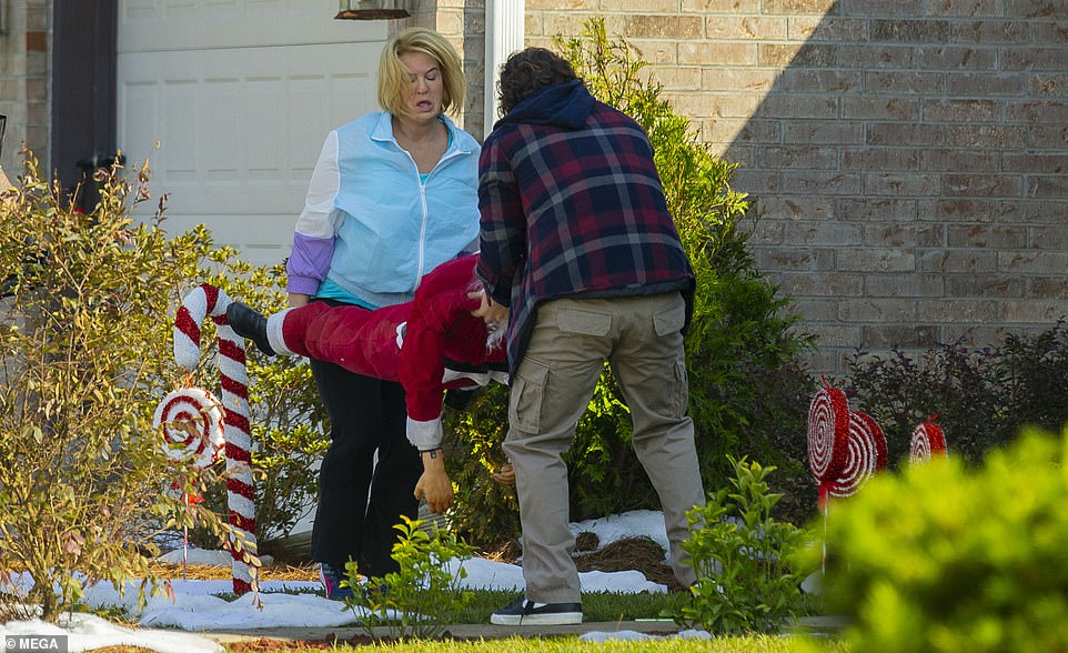 Decorating:During her scene on Wednesday, Zellwegger appeared to be setting up some Christmas decorations outside with the help of another actor