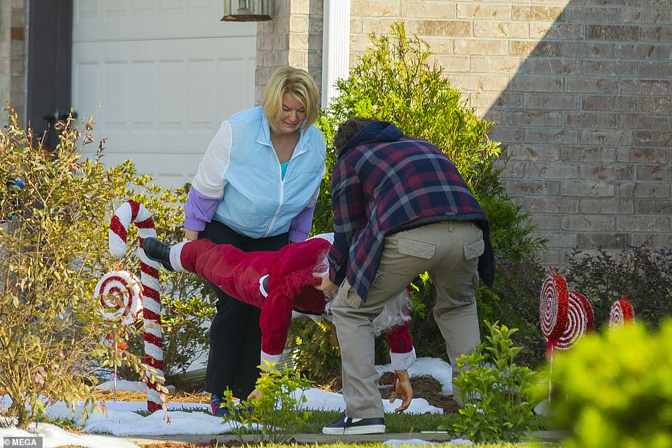 Surreal scene: The two lifted the mannequin up near a giant candy cane